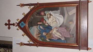 Stacja Drogi Krzyżowej nr XIV Pan Jezus złożony do grobu.